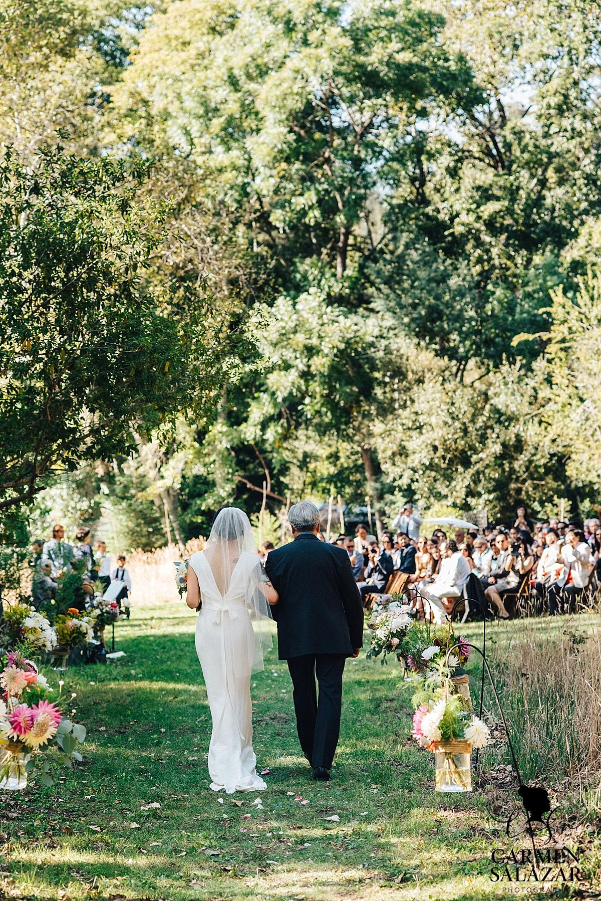 Father walking bride down floral aisle - Carmen Salazar