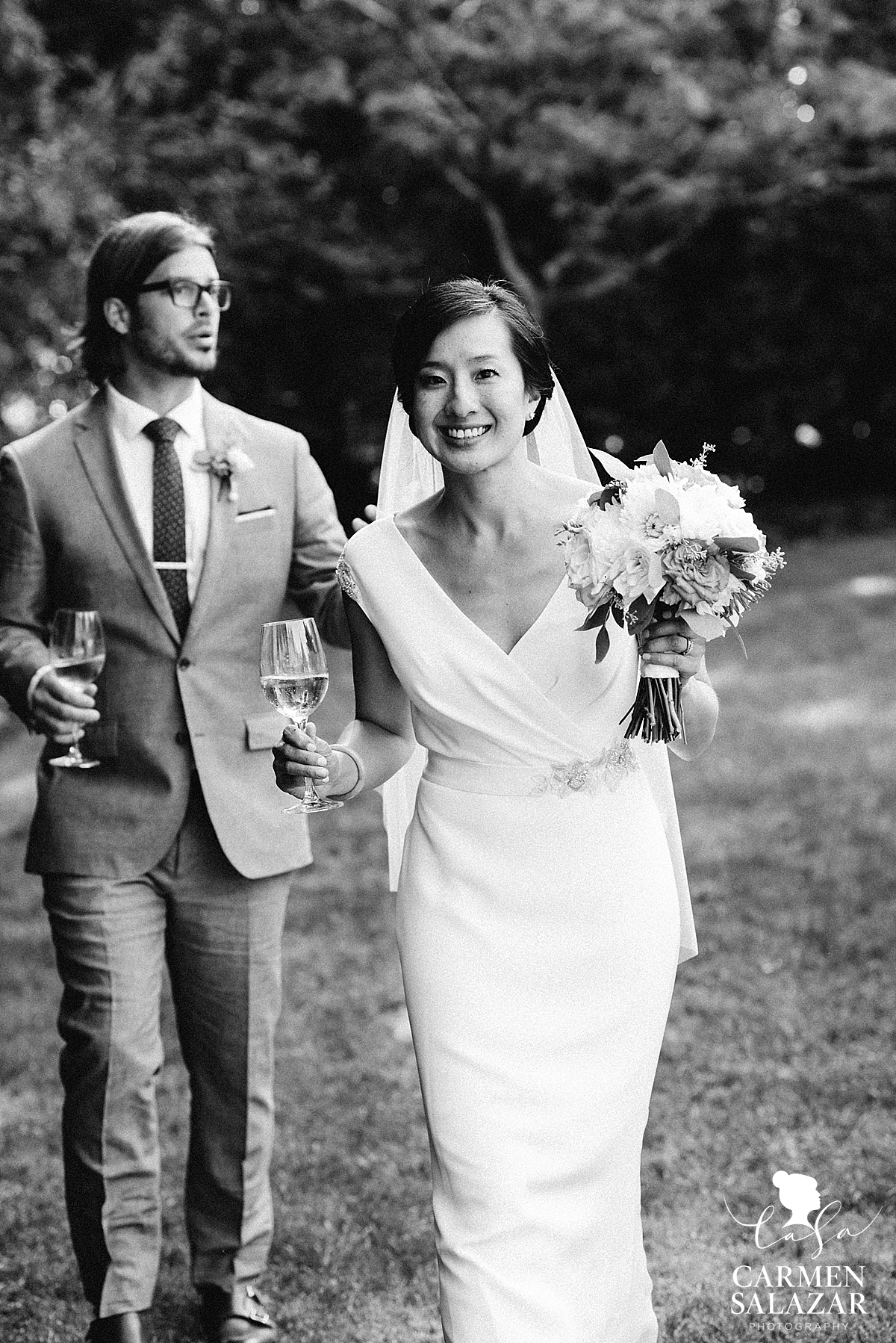 Black and white portrait of Bride and groom drinking California wine - Carmen Salazar