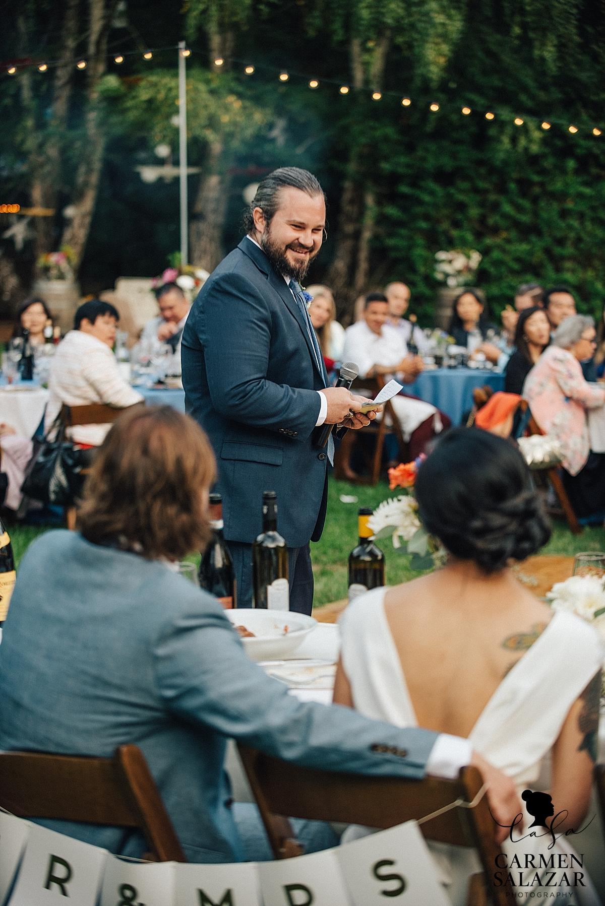 laughing best man giving sweet speech at wedding reception - Carmen Salazar