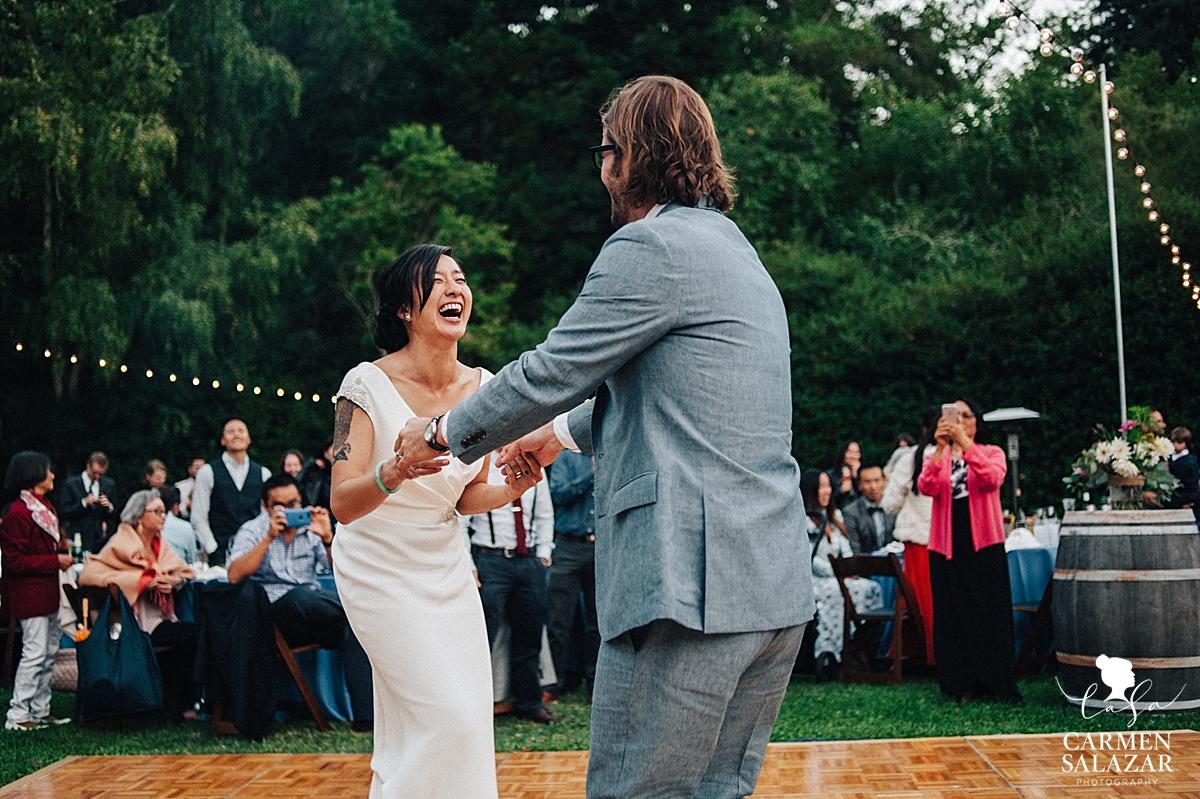 laughing bride at Sunset first dance at Santa Cruz outdoor wedding - Carmen Salazar
