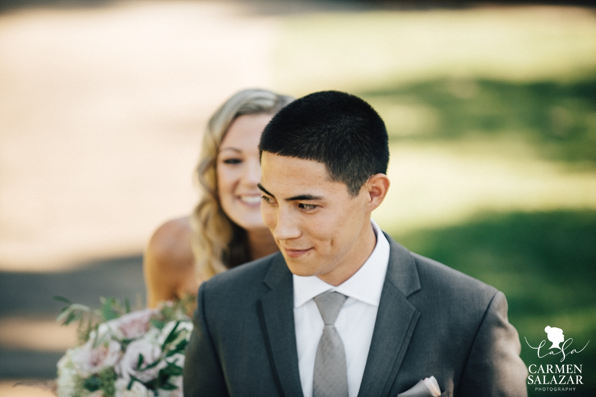 Grinning bride and groom at first look portraits - Carmen Salazar