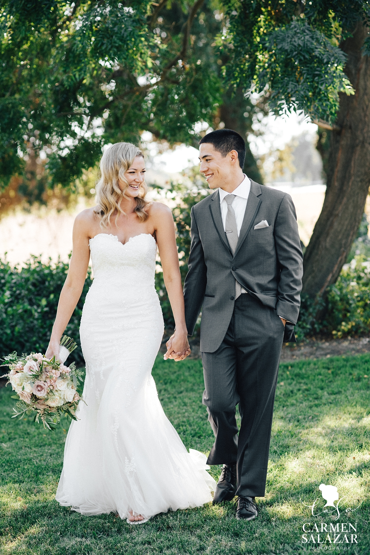 Sweet bride and groom at summer Scribner Bend winery wedding - Carmen Salazar
