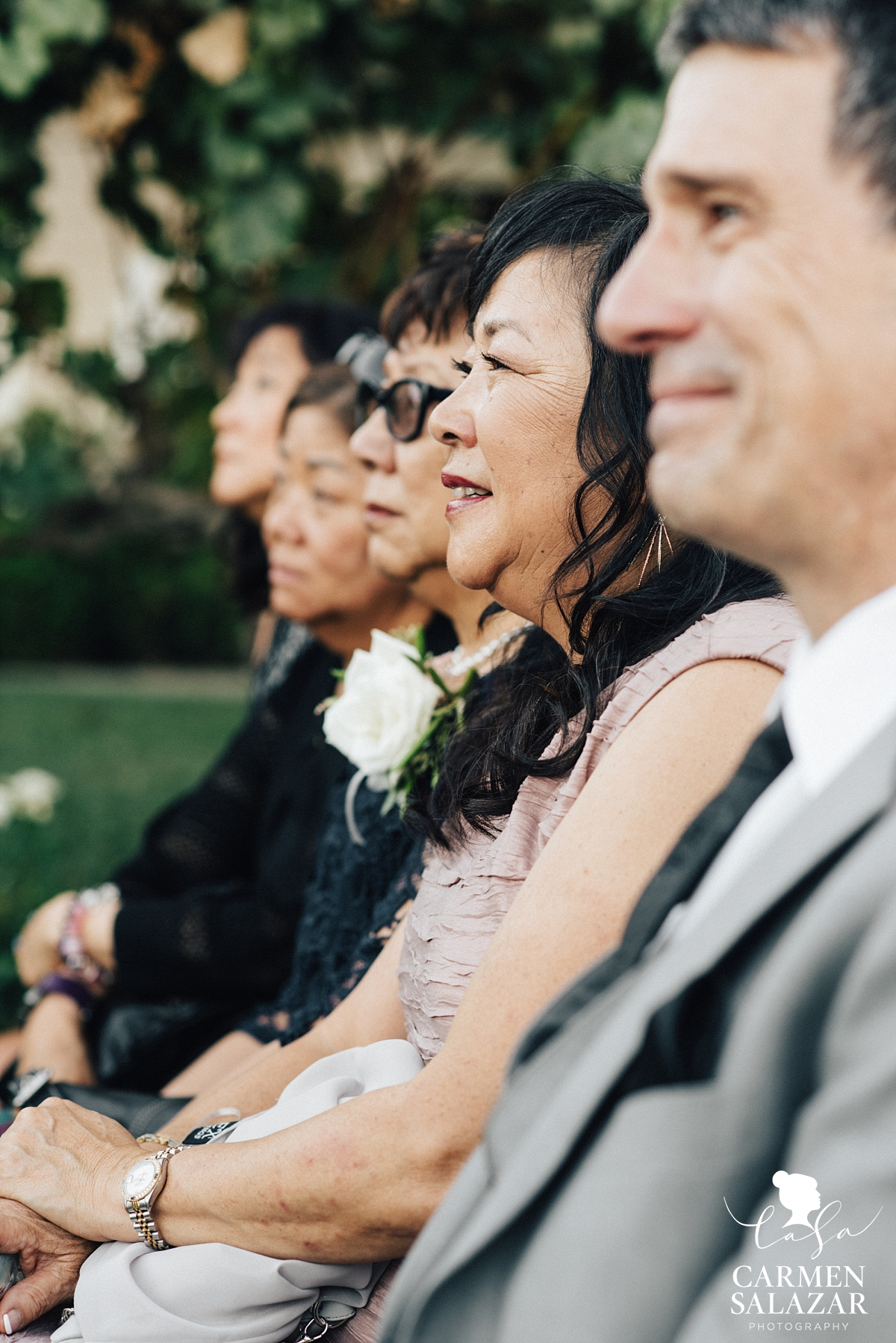 Happy mother of the groom at outdoor winery ceremony - Carmen Salazar