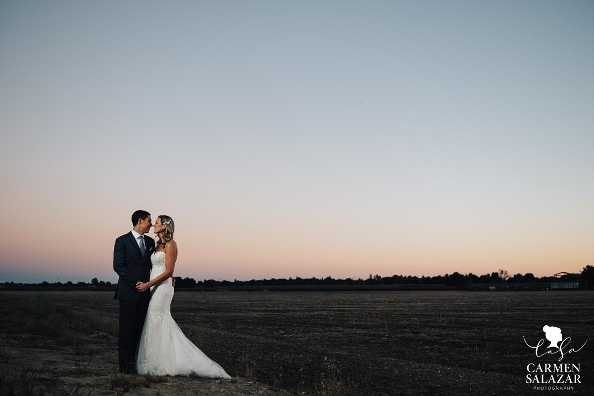 Romantic sunset vineyard wedding photography - Carmen Salazar