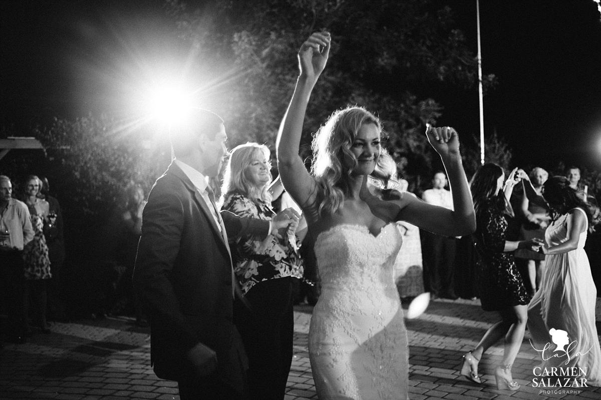 Bride dancing at Scribner Bend Vineyards - Carmen Salazar