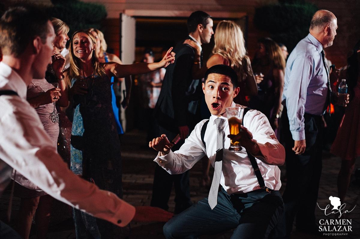 Groom dancing with beer at Scribner Bend - Carmen Salazar