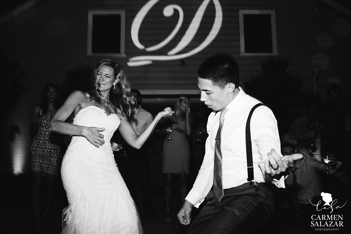 Bride and groom air guitar on the dance floor - Carmen Salazar
