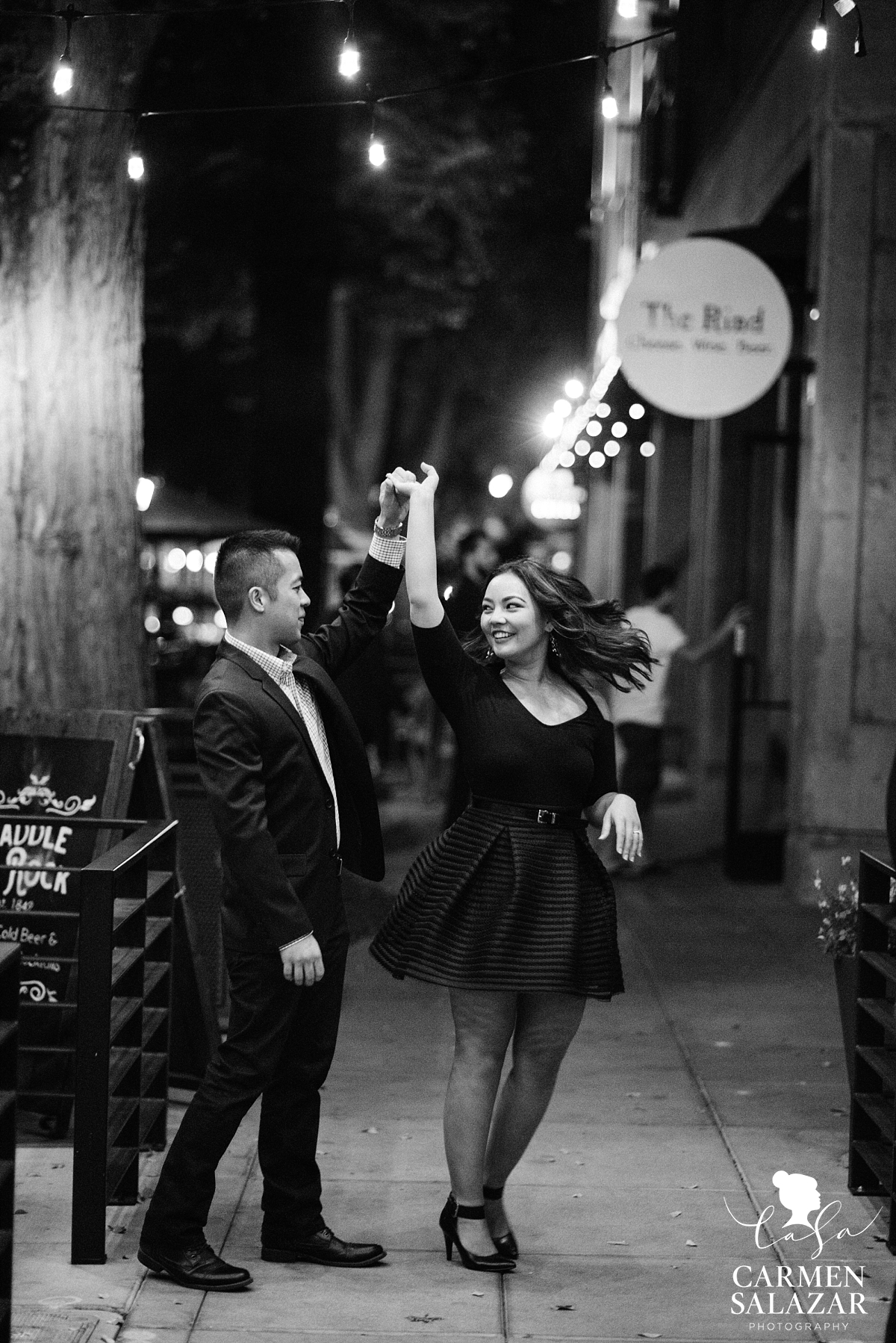Couple dancing in Downtown engagement session - Carmen Salazar