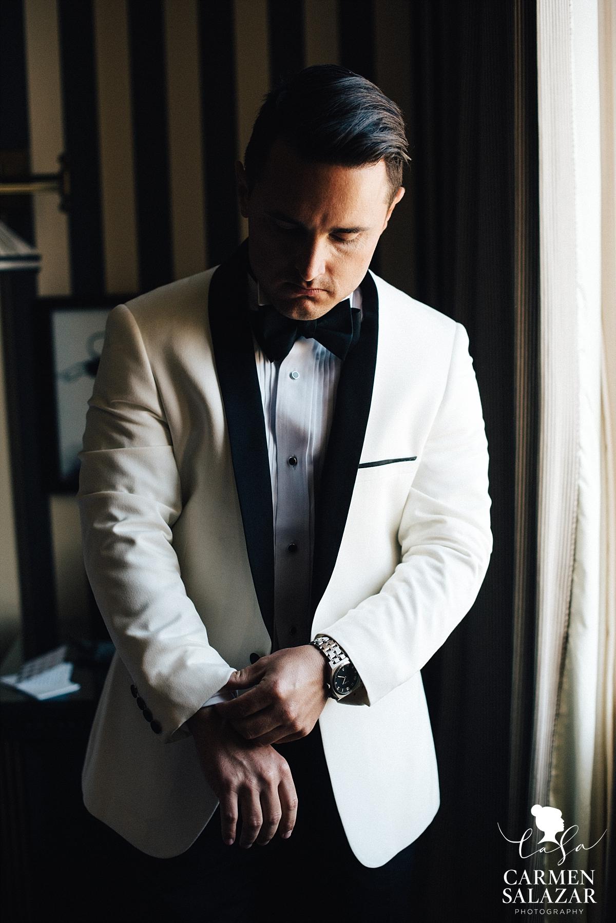 Dapper white tuxedo groom style - Carmen Salazar