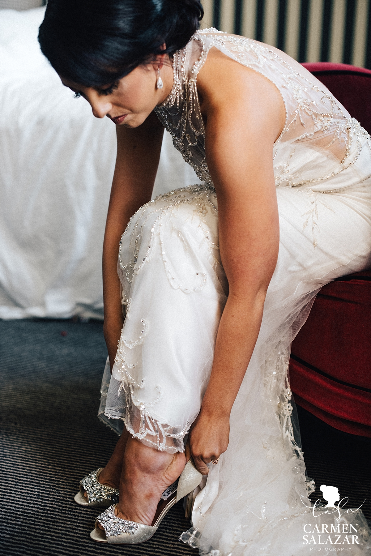 Bride putting on shoes at The Citizen - Carmen Salazar