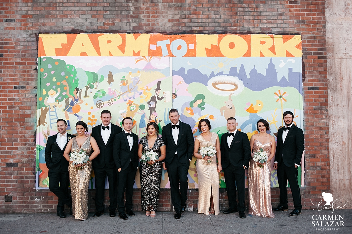 Colorful bridal party portraits with urban mural - Carmen Salazar