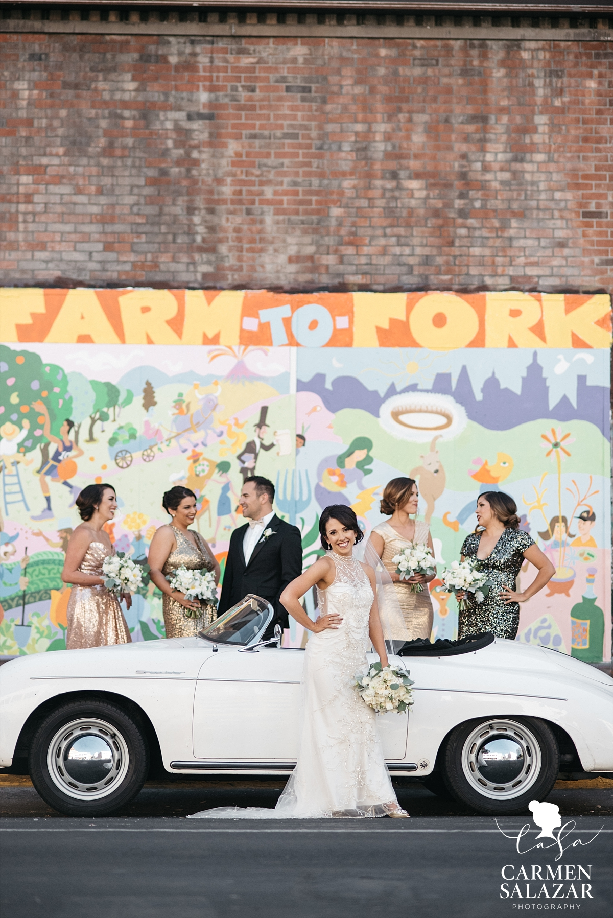 Bride and bridesmaids posing with vintage Porsche - Carmen Salazar