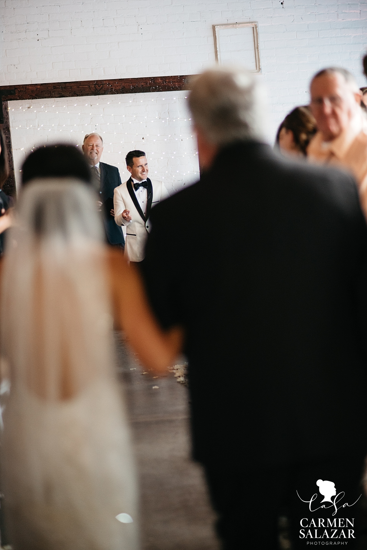 Grinning groom excited to see his bride - Carmen Salazar
