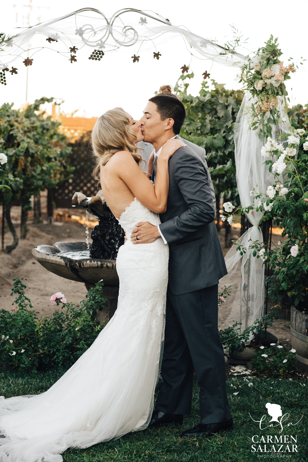 Bride and groom first kiss at Scribner Bend ceremony - Carmen Salazar
