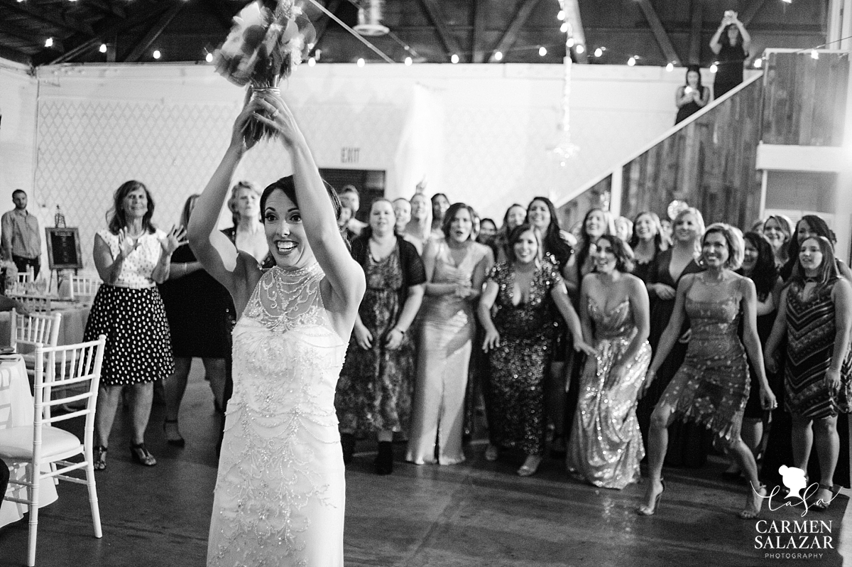 Bouquet toss at Studio 817 fall wedding - Carmen Salazar