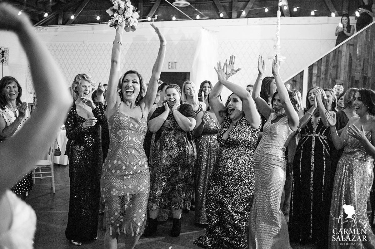 Happy friend of bride catches bouquet at Studio 817 - Carmen Salazar