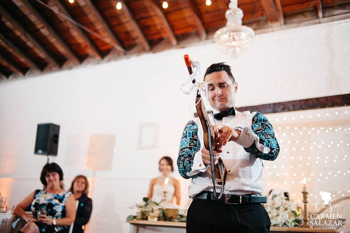 Garter toss slingshot gun at Sacramento wedding reception - Carmen Salazar
