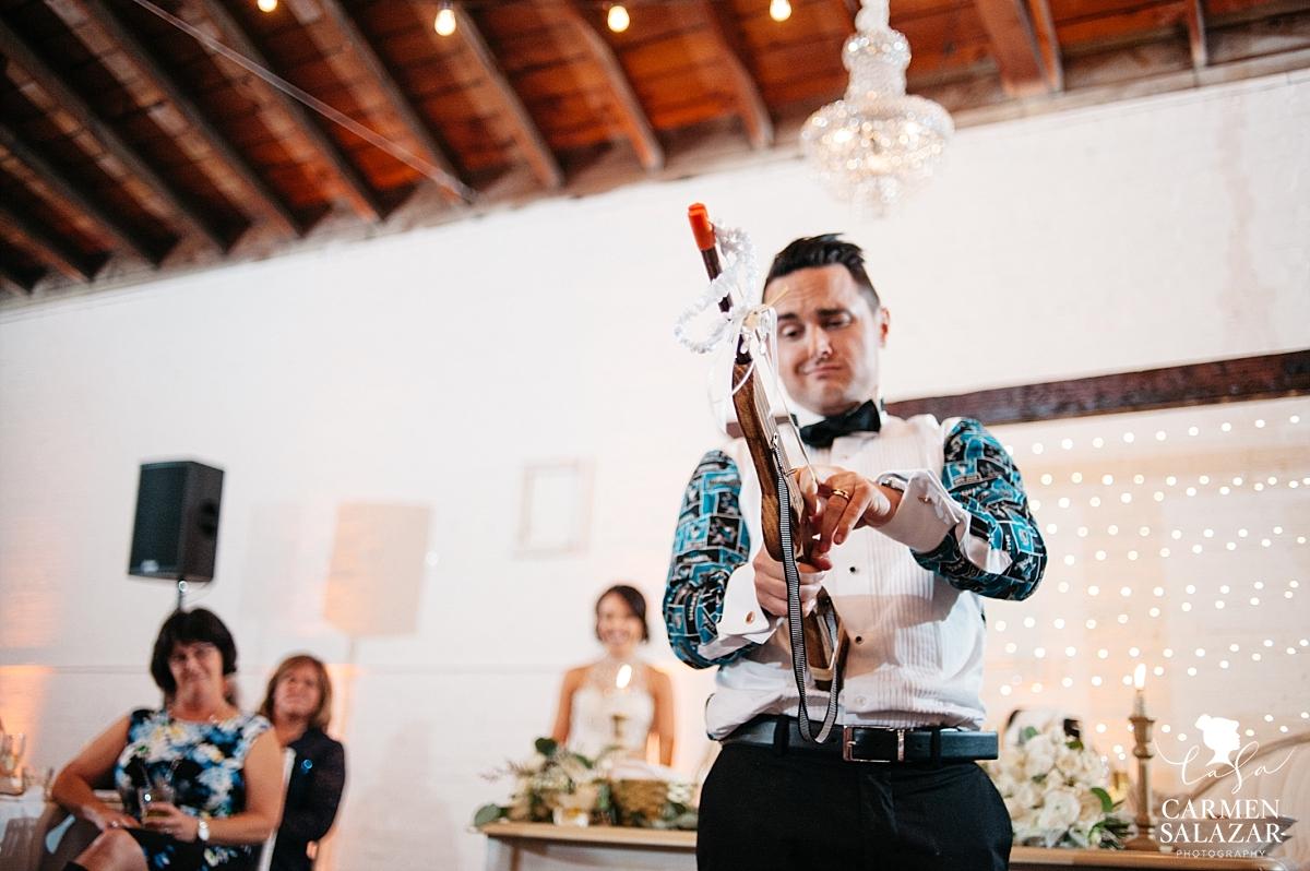 Garter toss slingshot gun at Sacramento wedding reception - Carmen Salazar