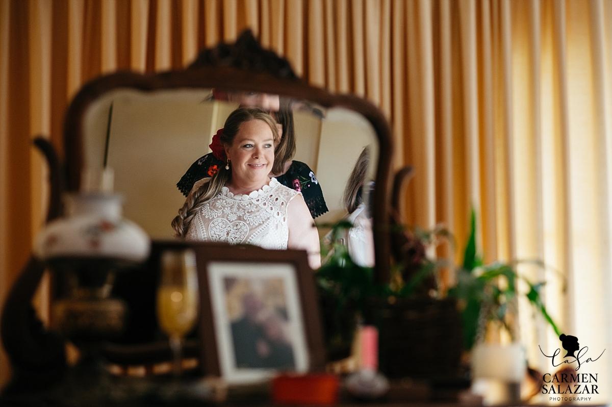 Bride putting on BHLDN dress at private estate - Carmen Salazar