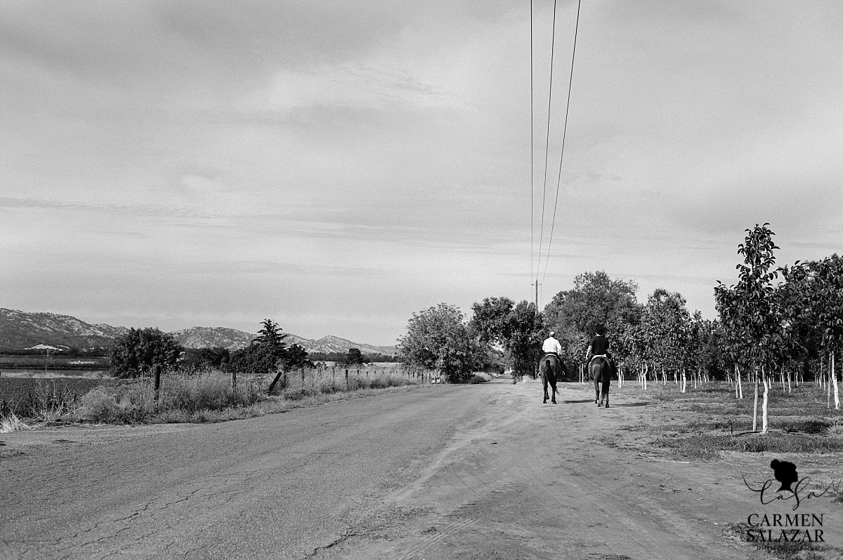 Father of the groom riding horses with son - Carmen Salazar