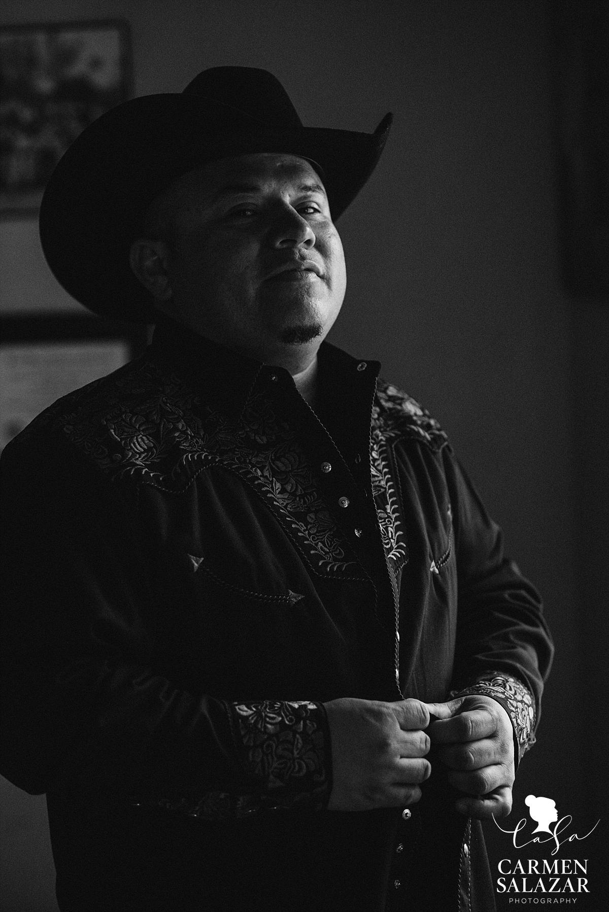 Cowboy groom getting dressed at Winters property - Carmen Salazar