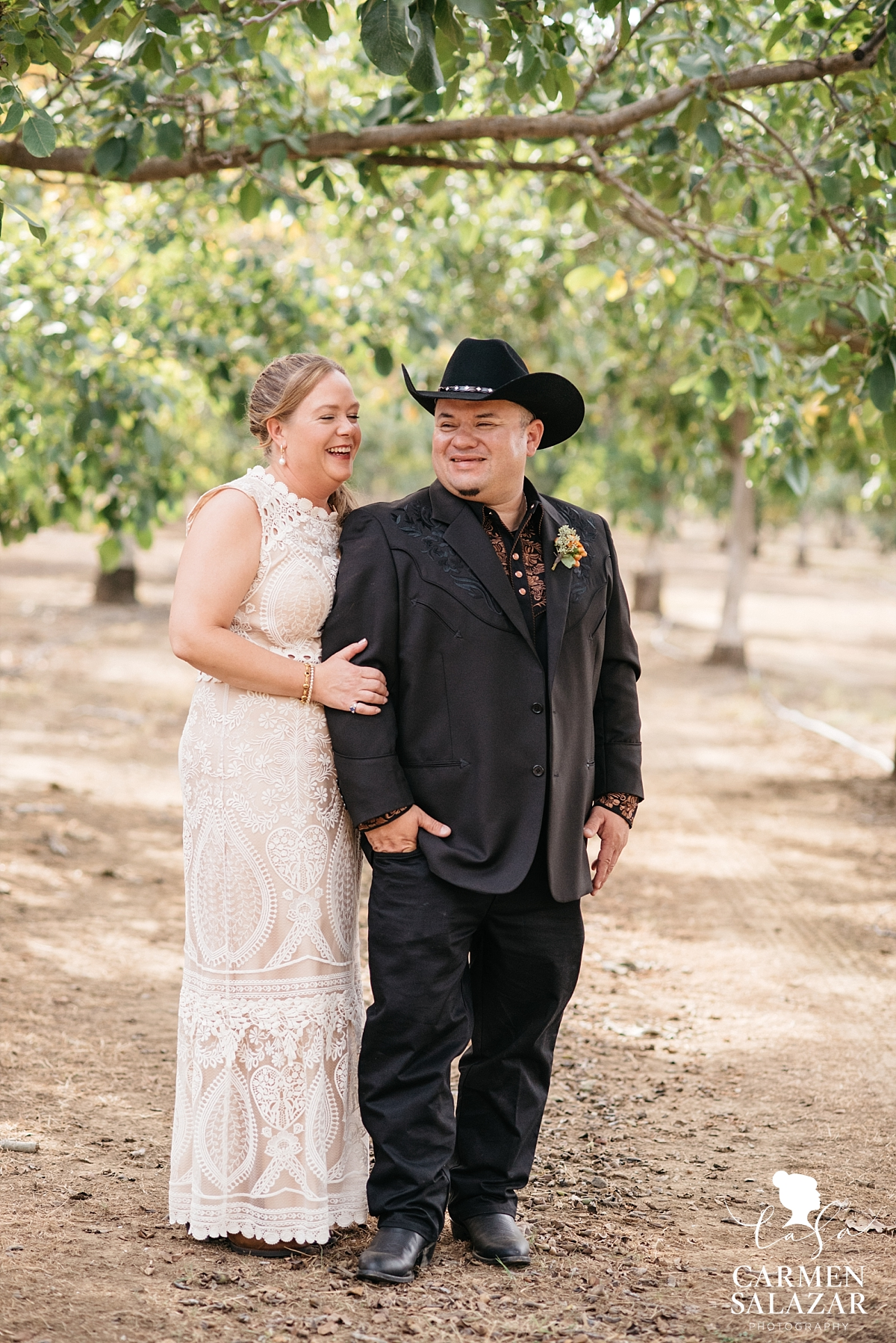 Laughing bride and groom at farm first look - Carmen Salazar
