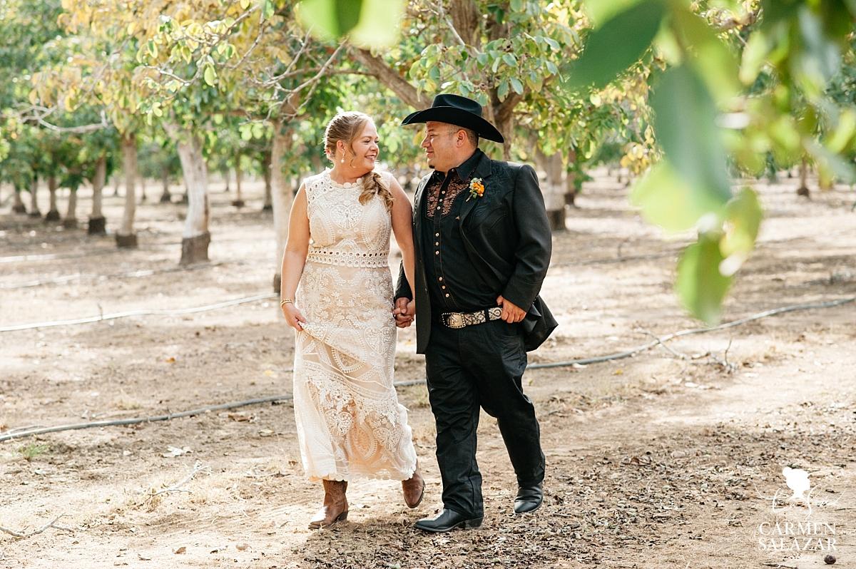 Bride and groom holding hands at Winters wedding - Carmen Salazar