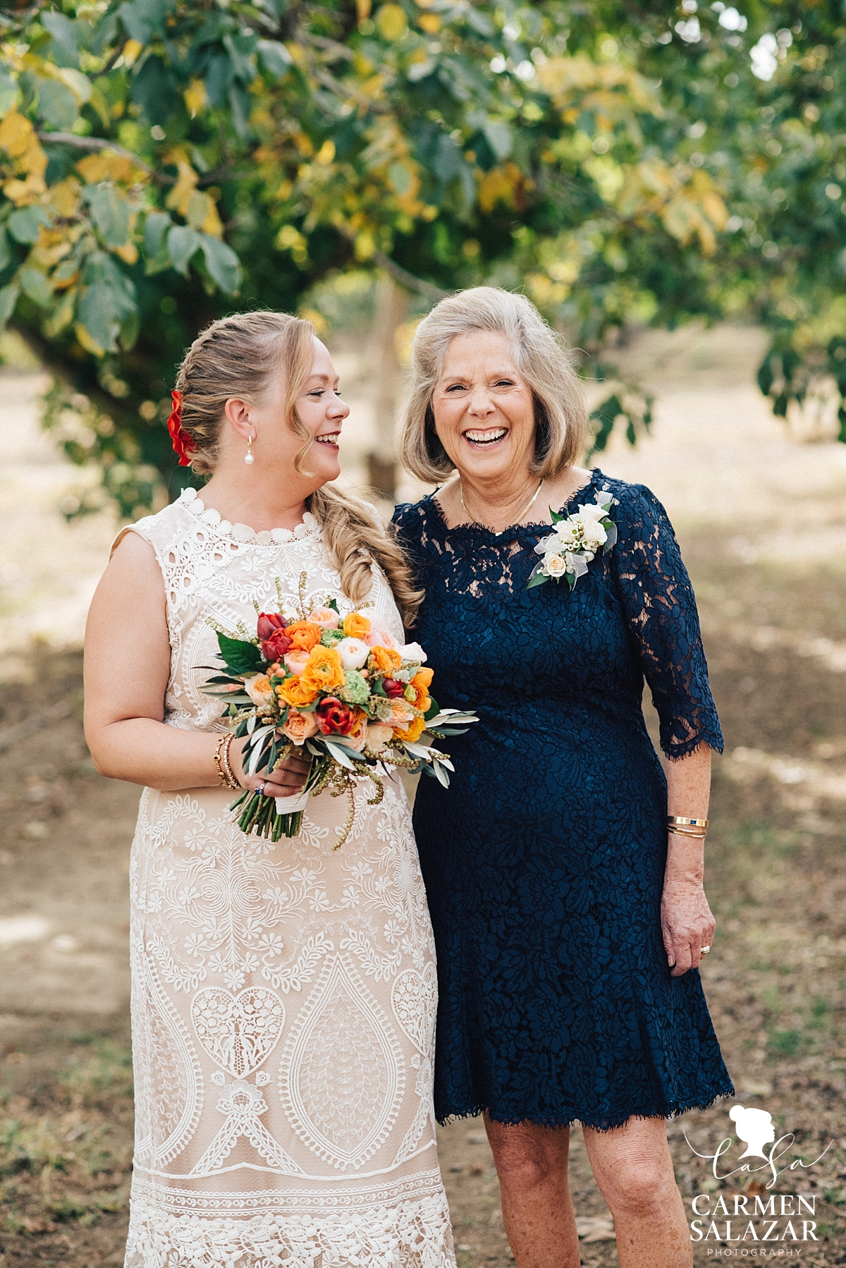 Bride laughing with her mom at family farm - Carmen Salazar