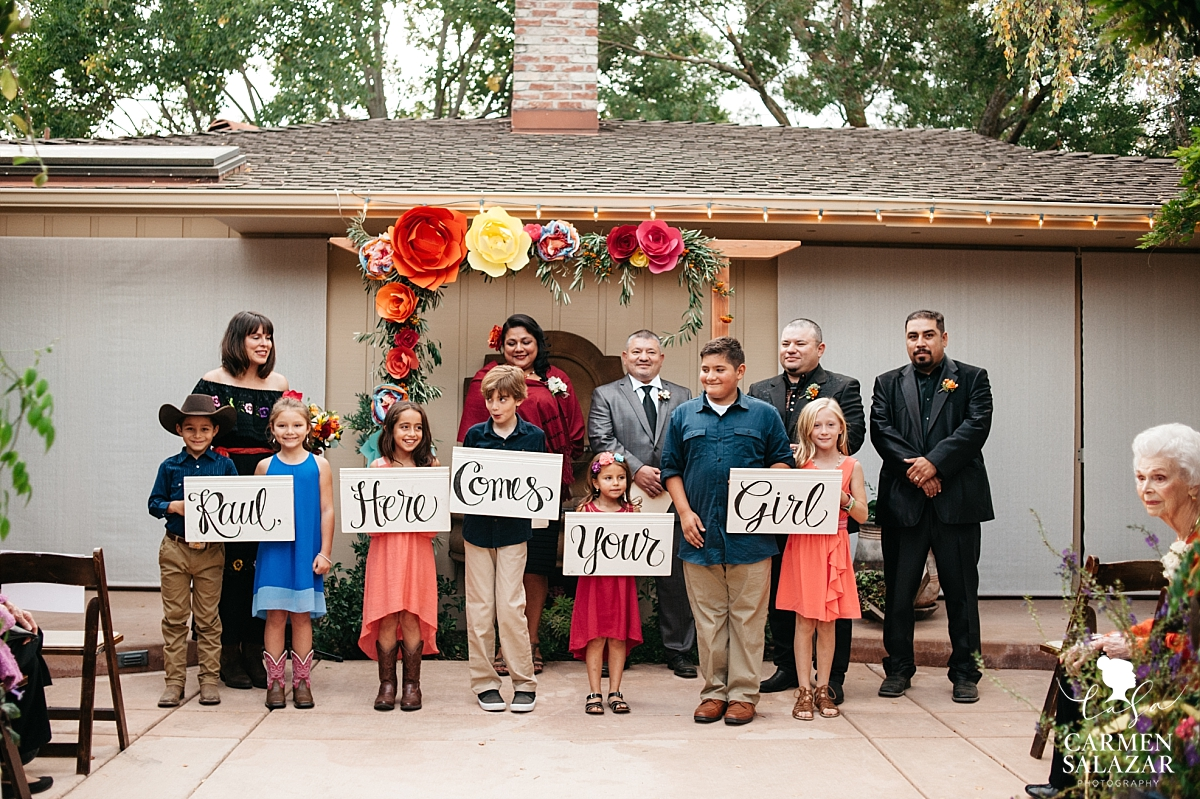 DIY wedding aisle signs with adorable bearers - Carmen Salazar