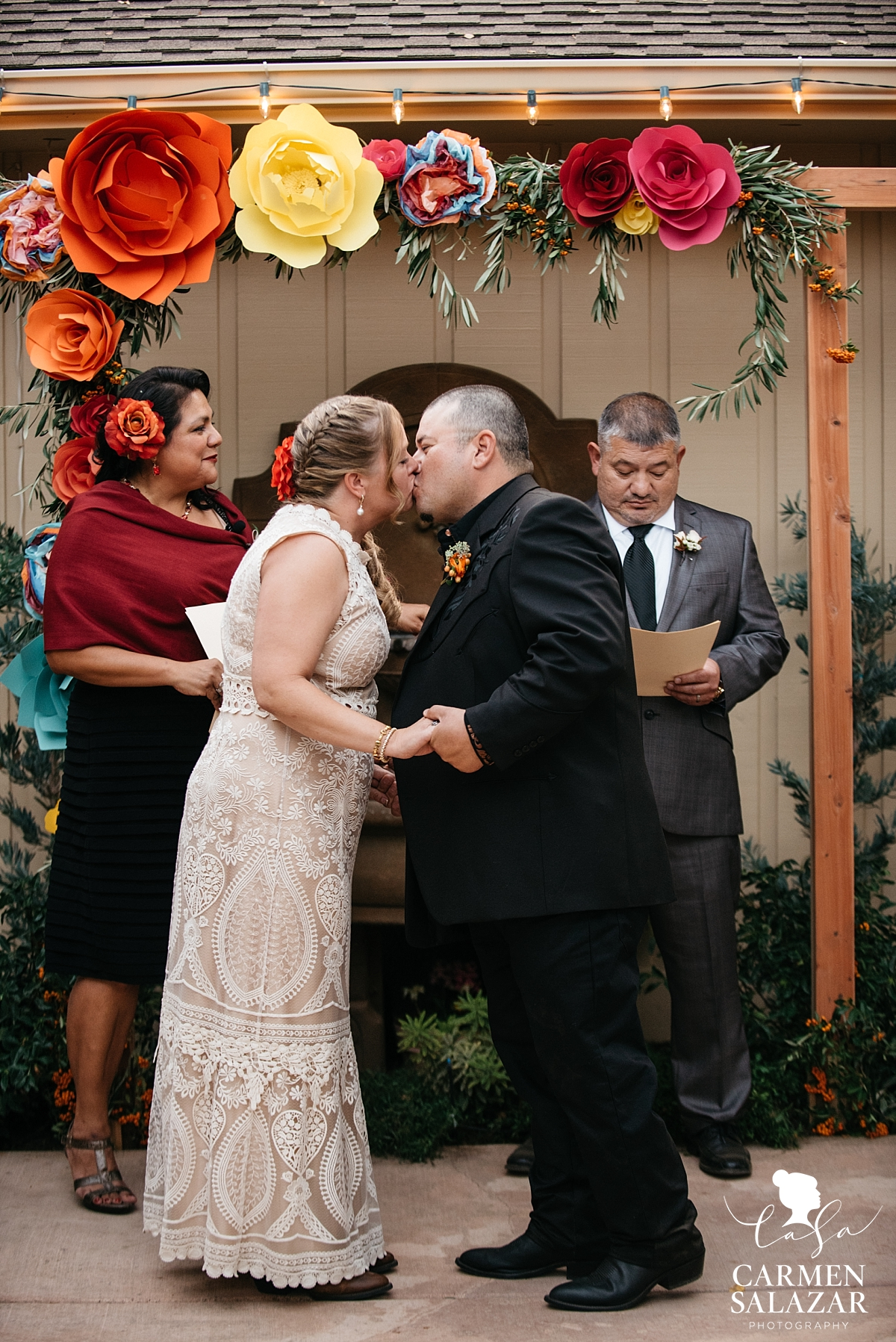 First kiss at Mexican private estate wedding ceremony - Carmen Salazar