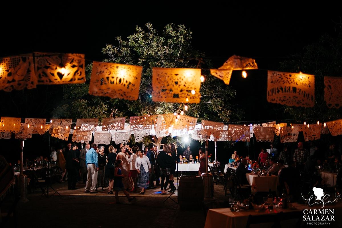 Night dance floor with papeles at farm wedding - Carmen Salazar