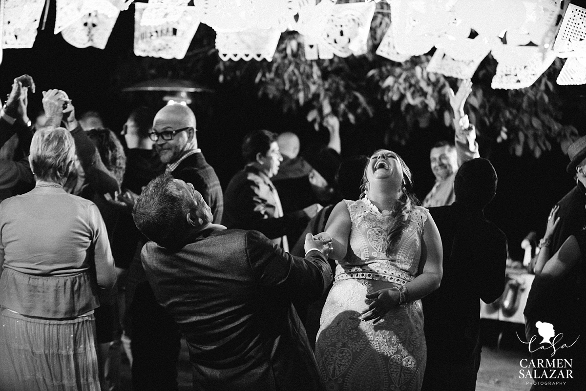 Laughing bride dancing at private estate wedding - Carmen Salazar