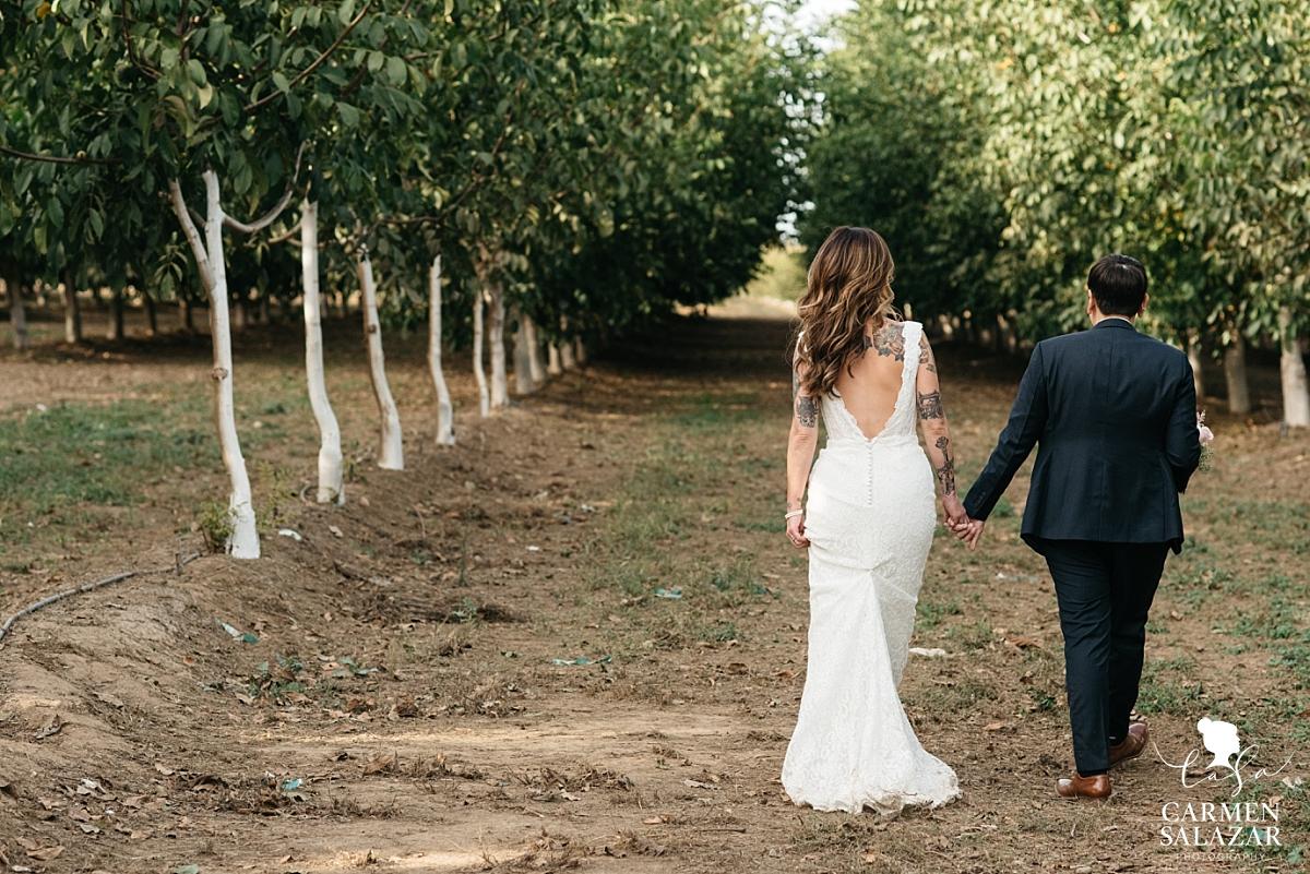 LGBT couple walking to wedding reception - Carmen Salazar