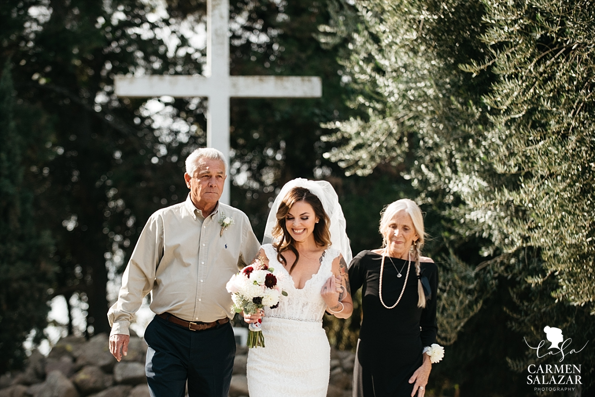 Bride walking with parents at Our Lady of Sorrows Chapel - Carmen Salazar
