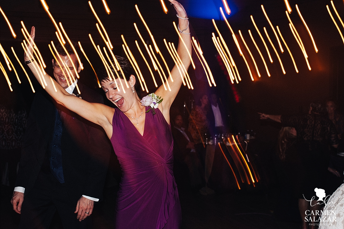 Fun light stream wedding dance floor photography - Carmen Salazar