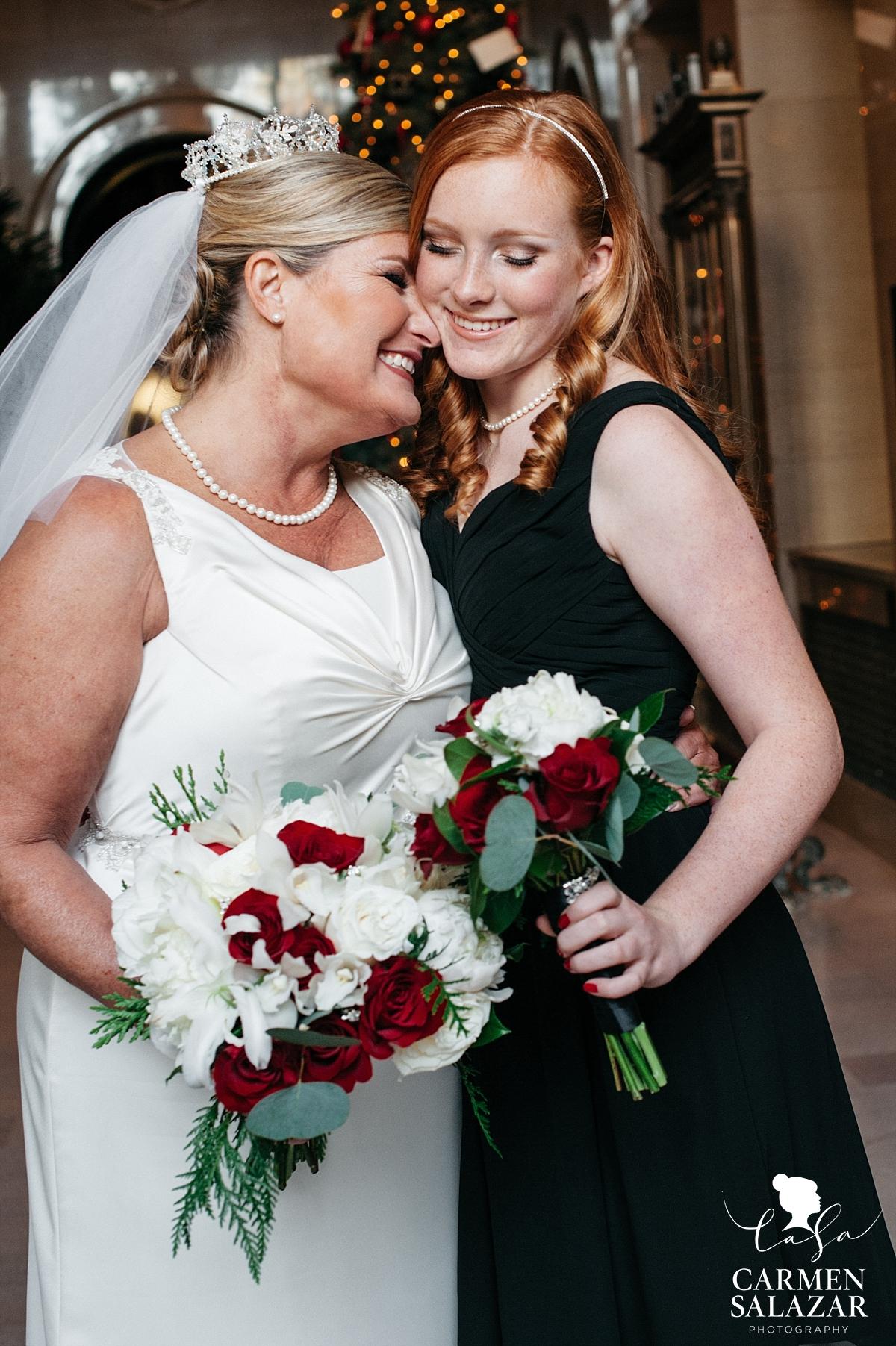 Bride hugs daughter junior bridesmaid - Carmen Salazar
