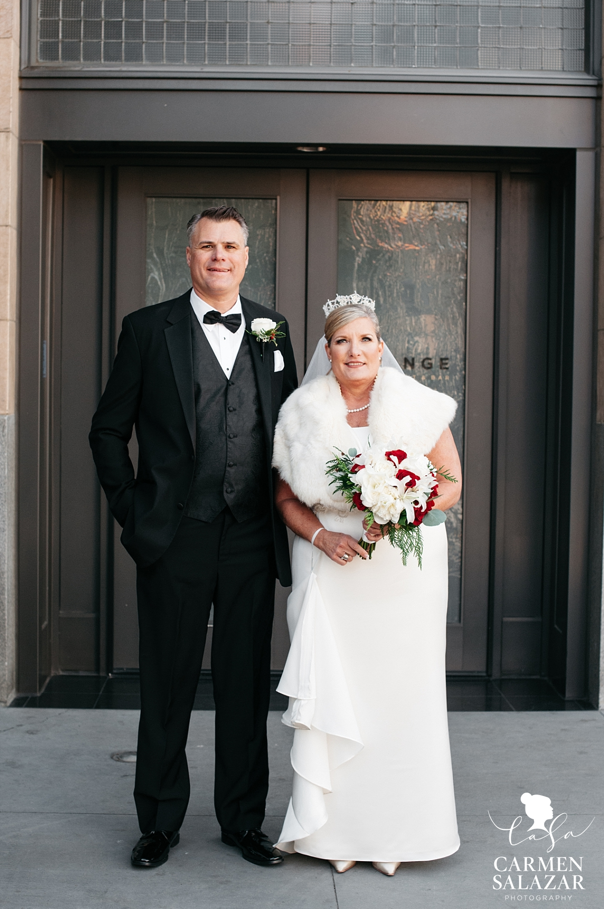 Bride and groom portraits in front of The Grange - Carmen Salazar