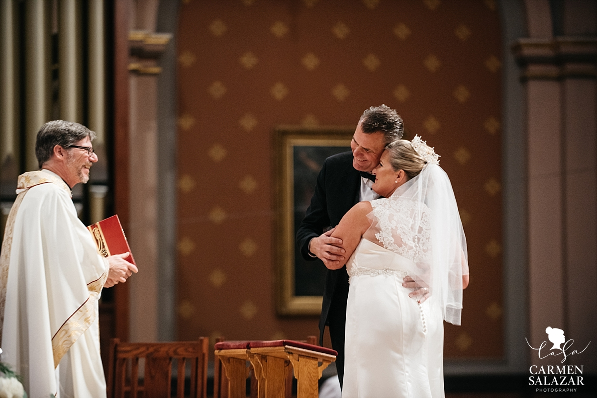 Bride and groom married by family priest - Carmen Salazar