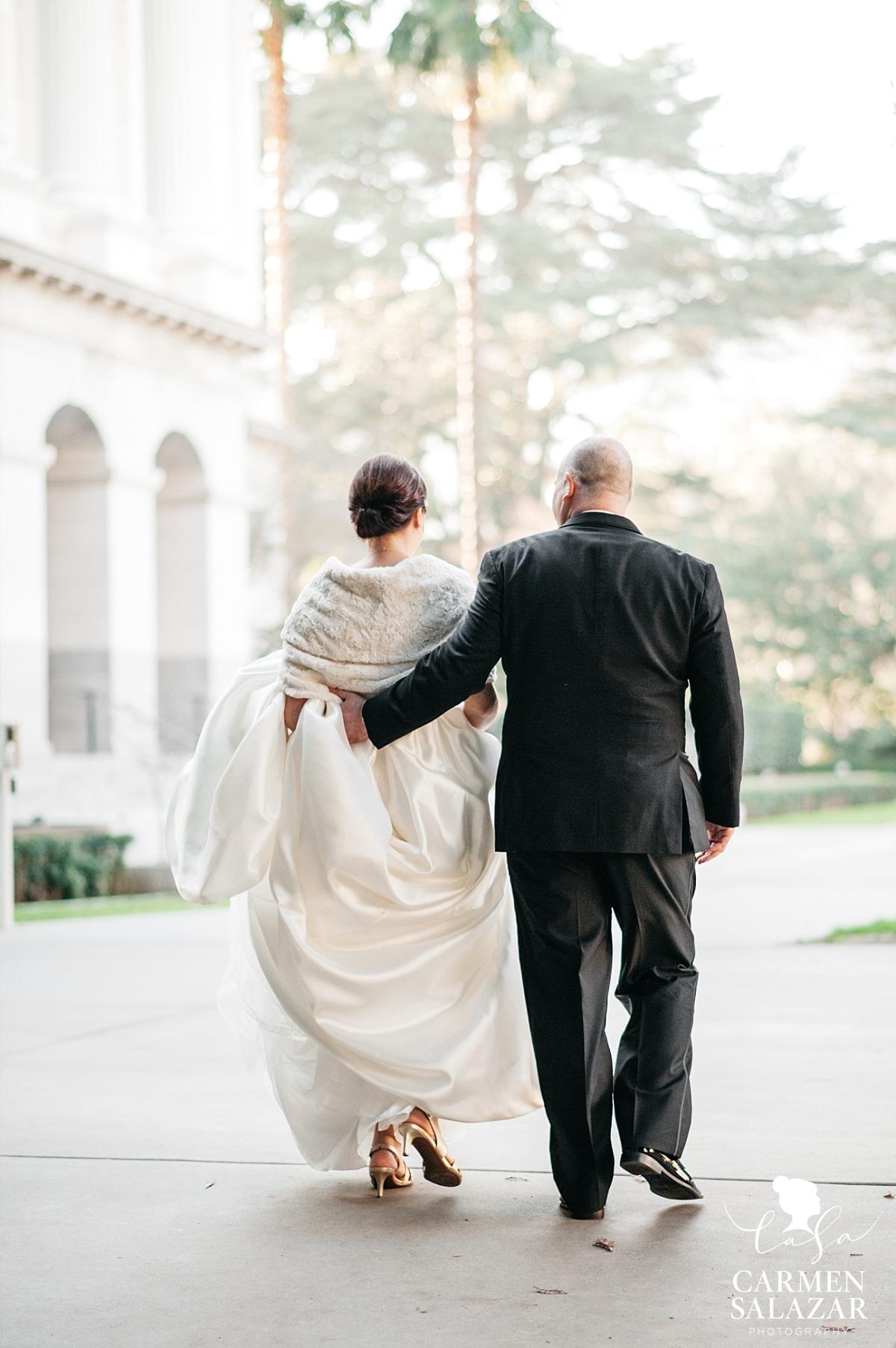 Bride and groom walk at Capitol Park - Carmen Salazar