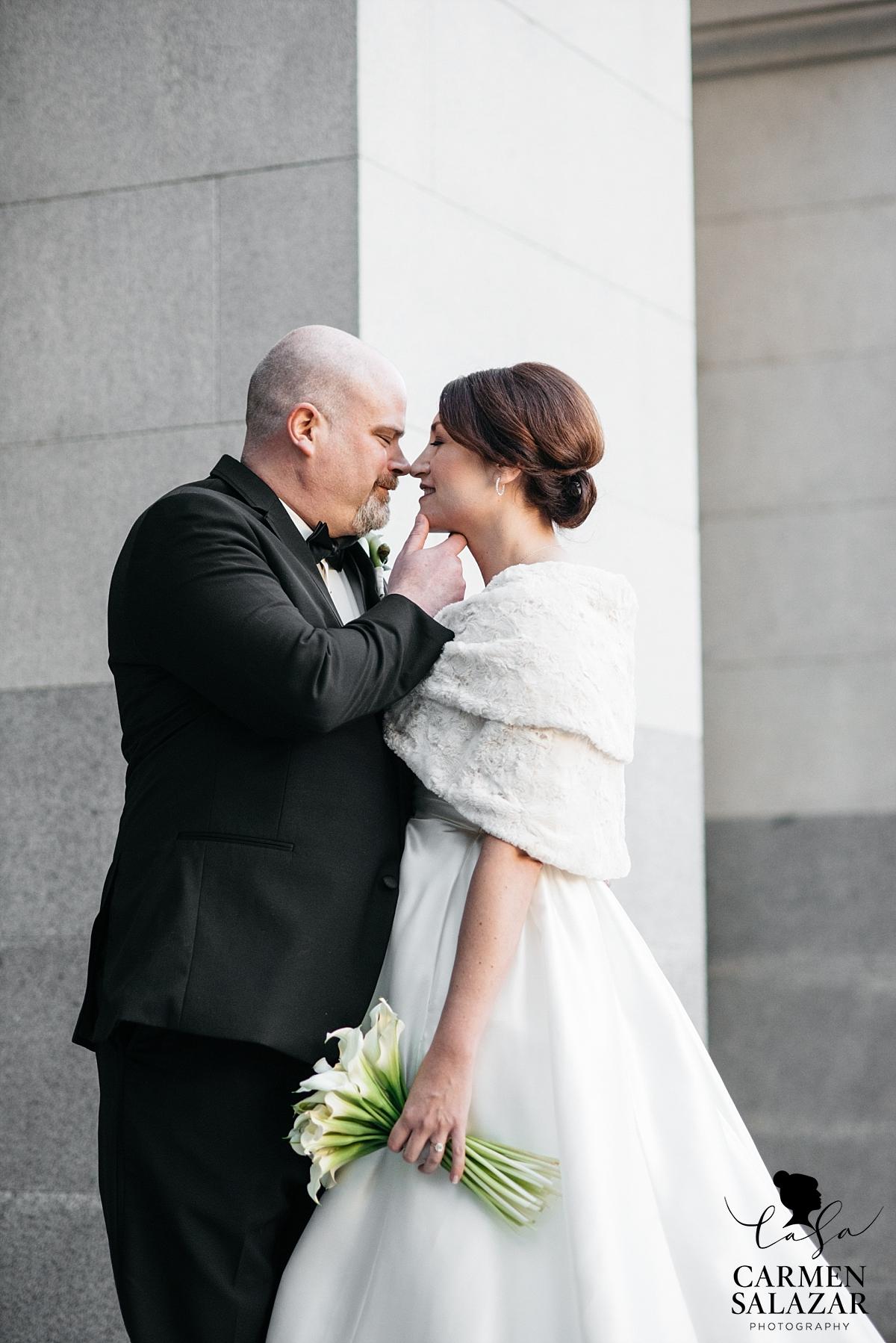 Bride and groom lovingly embrace - Carmen Salazar