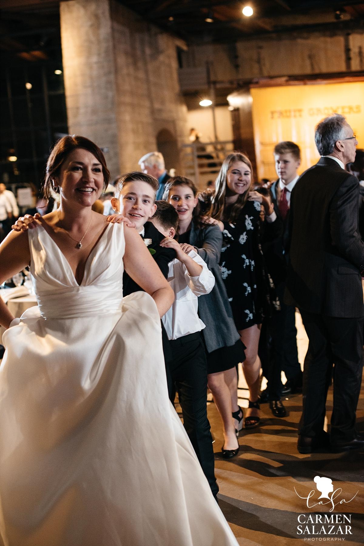 Conga line at Sacramento museum wedding - Carmen Salazar