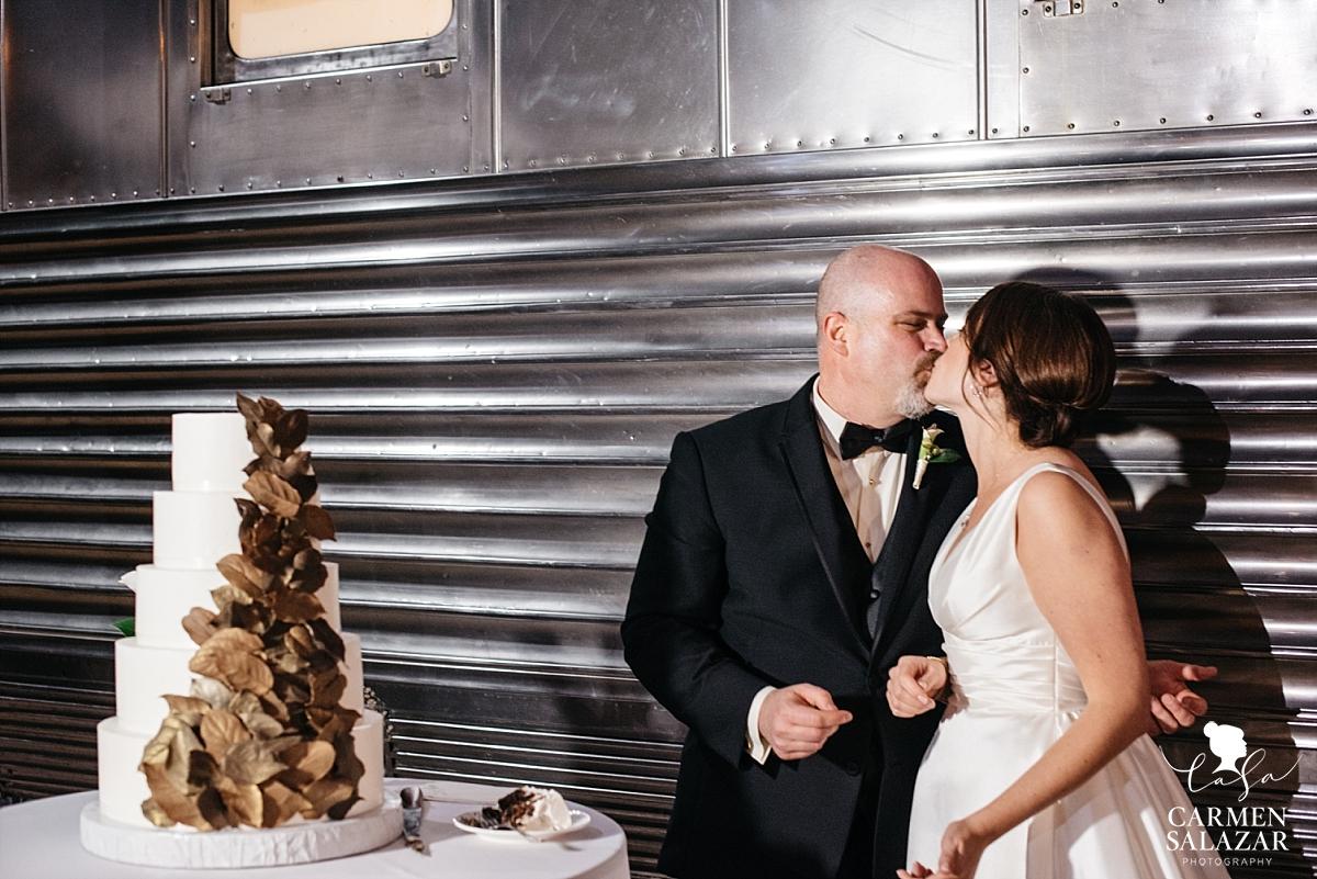 Newlyweds smooch at cake cutting - Carmen Salazar