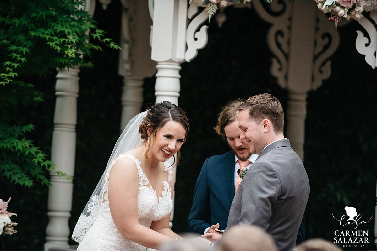 Happy bride and groom at ceremony - Carmen Salazar