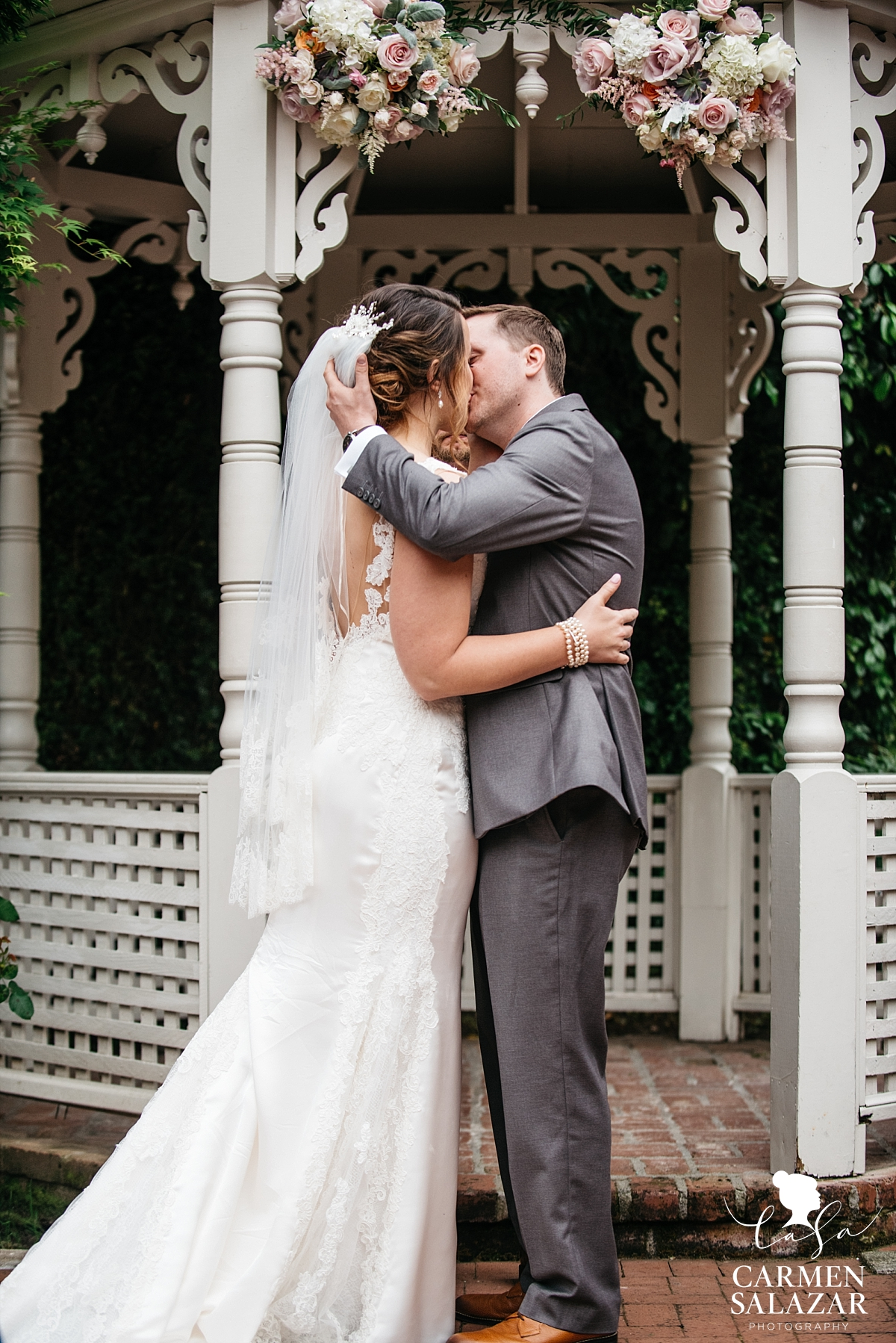 First kiss at Vizcaya outdoor wedding - Carmen Salazar
