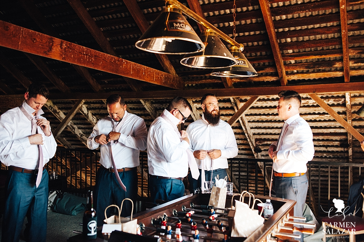 Groomsmen getting ready in barn loft - Carmen Salazar