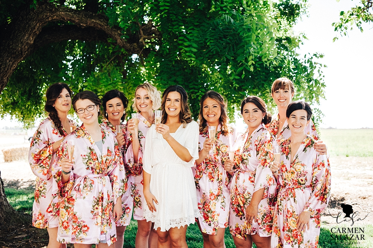 Bridemaids toasting outside with champagne - Carmen Salazar
