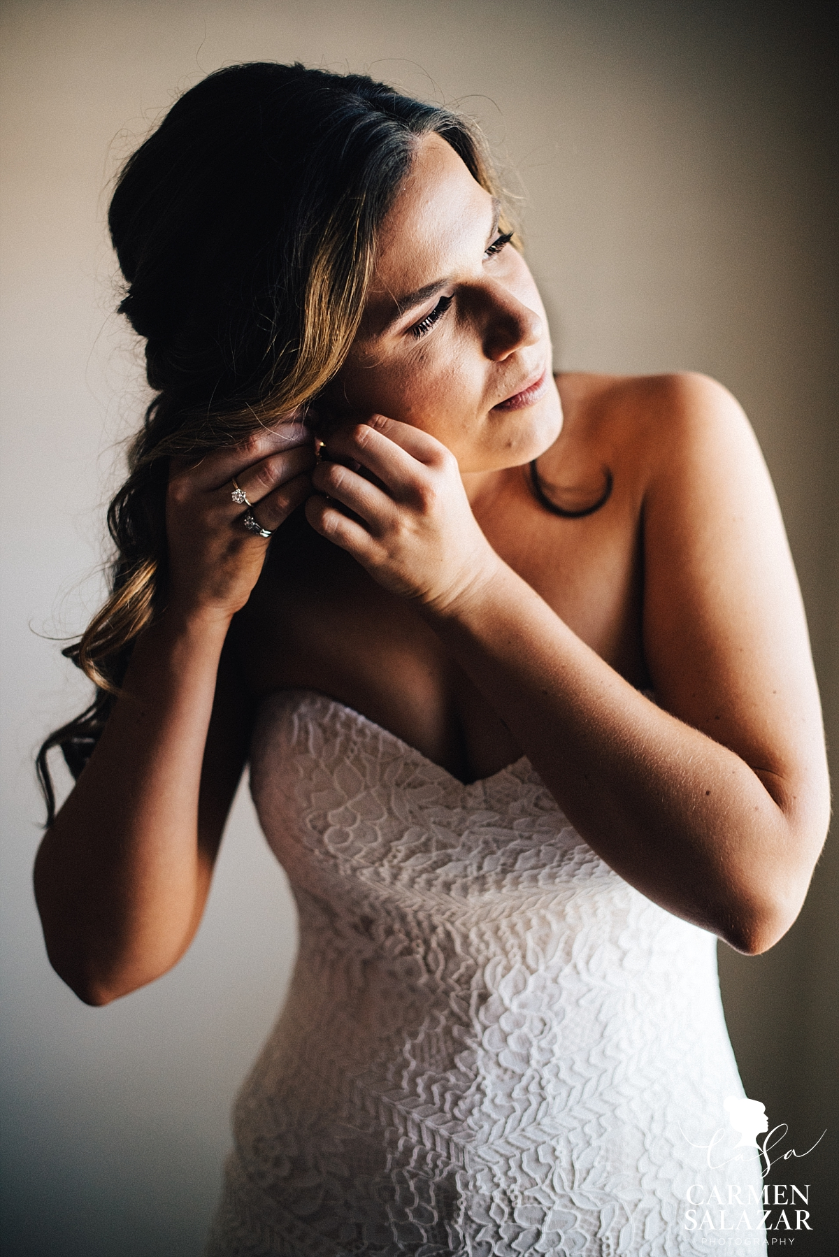 Bride getting ready in bohemian lace gown - Carmen Salazar