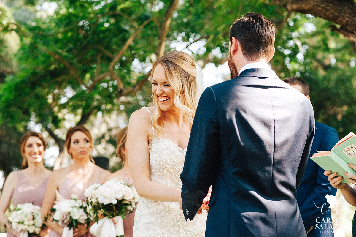 Bride giggling at groom's wedding vows - Carmen Salazar