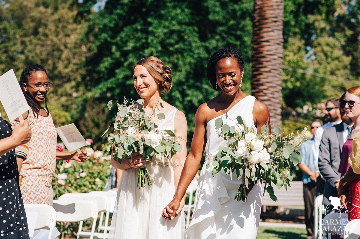 Two brides walk the aisle at McKinley Rose Garden - Carmen Salazar