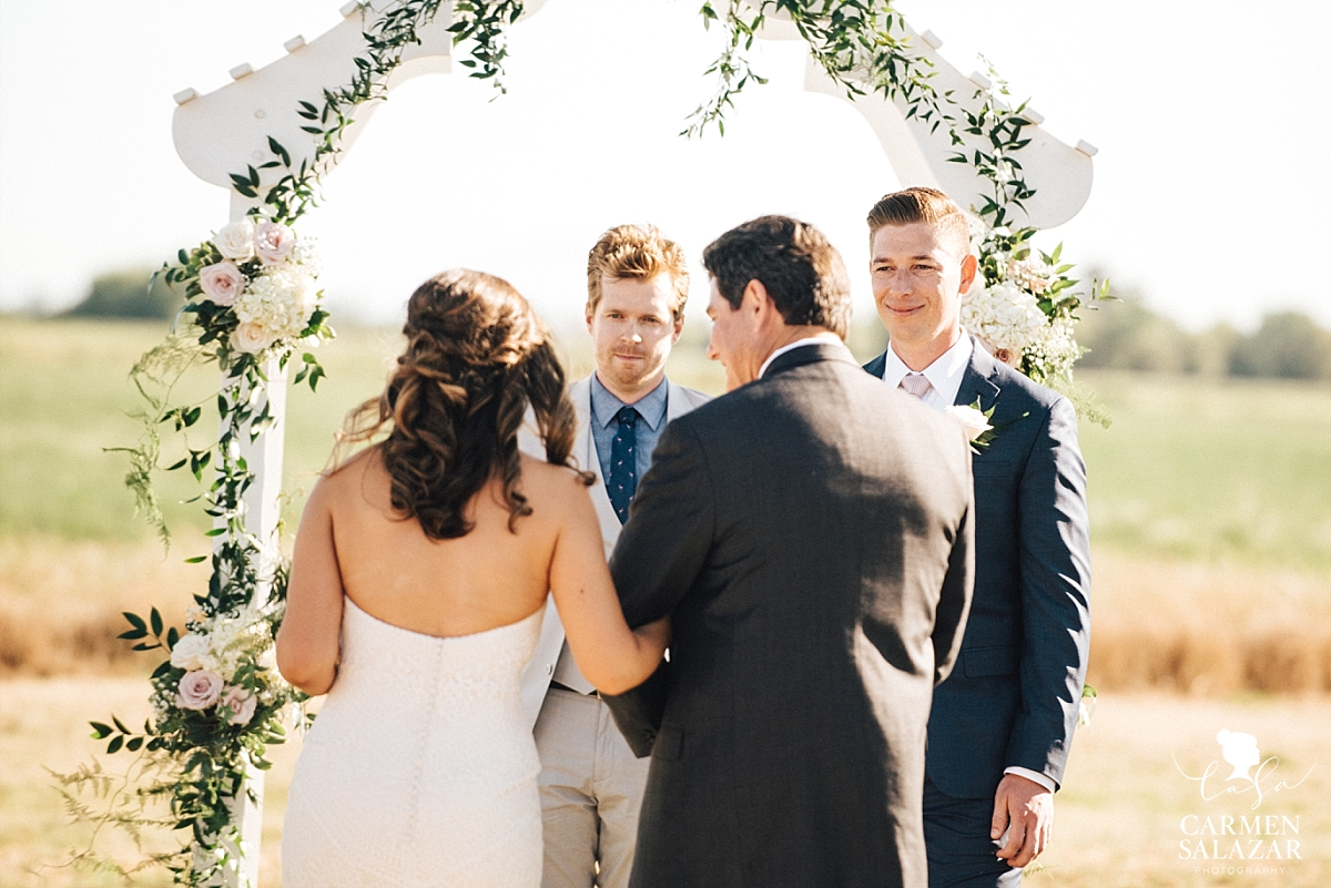 Groom's first look at bride during ceremony - Carmen Salazar